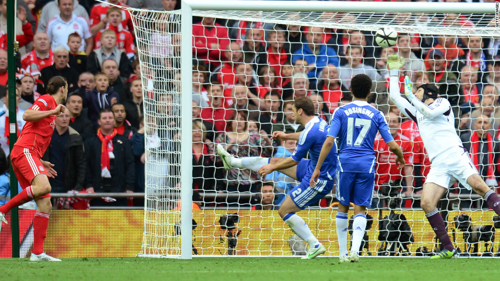 Liverpool came from 2-0 down and thought the scores had been leveled late in the match, but Chelsea goalkeeper Petr Cech made a desperate save from Andy Carroll's header underneath the crossbar.
