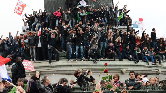 Hollande supporters celebrate his win Sunday at Place de la Bastille in Paris.