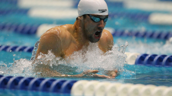 And as swimmers race beneath the sweeping curves of the Aquatics Center, the pressure will be on American Michael Phelps to replicate his success in the last Olympics, when he took home a record-breaking eight golds.