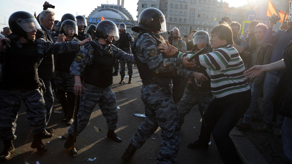 "Opposition supporters clash with riot police during the ""March of Millions"" protest on Sunday."