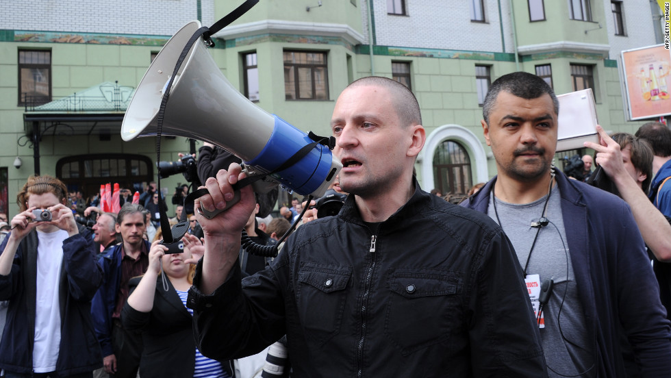 Leftist radical group leader Sergei Udaltsov, center, attends Sunday's rally. He was among the people arrested.