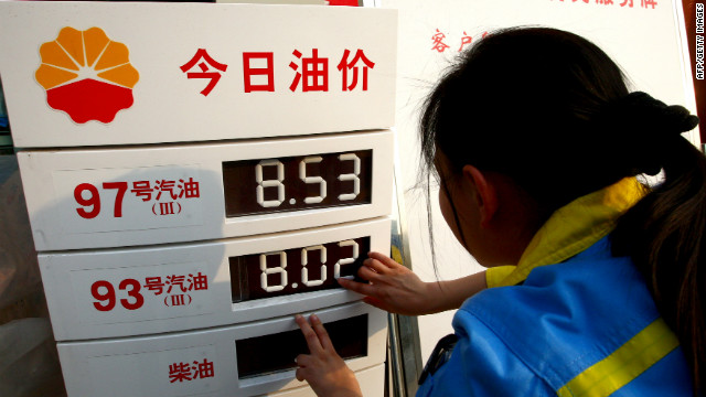 A worker changes the price panel at a petrol station in Suining, southwest China's Sichuan province on March 27, 2012.
