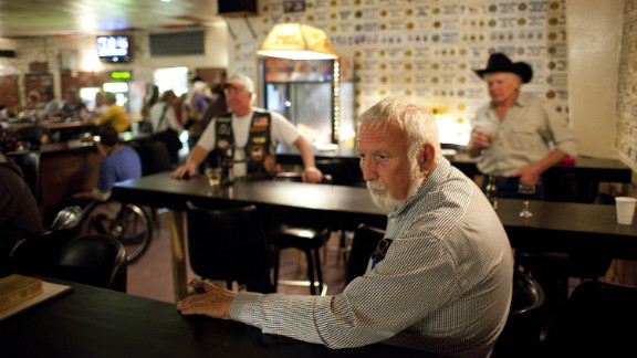 Former Mayor Jack Henderson quietly smokes a cigar at the VFW hall in Tombstone as he waits for the vote to be tallied. He lost a recall election in March to challenger Stephen Schmidt, a local bar owner.