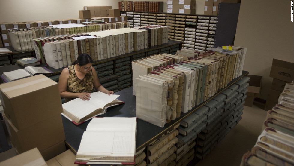 Sosa, Tombstone's archivist, searches for documents at the Cochise County Recorder's Office in Bisbee, Arizona. She is looking for evidence supporting Tombstone's water rights case against the U.S. Forest Service.