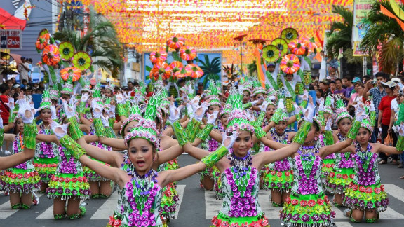 """The annual week-long Coco Festival is held in San Pablo City to honor the patron Saint Paul the Hermit .  A highlight is the street dancing competition between schoolchildren dressed in costumes made from coconuts. iReporter Toni Gutierrez says the five-time consecutive winner San Pablo Central Elementary School (pictured) """"signifies determination and the importance of keeping values and tradition alive."""""""