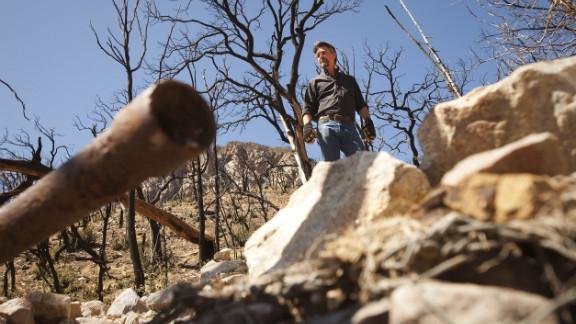 Kevin Rudd surveys broken pipe at one of Tombstone's springs above Sierra Vista, Arizona.