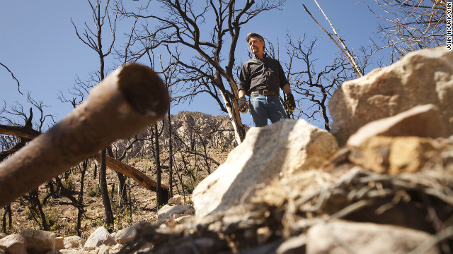 Kevin Rudd surveys broken pipe at one of Tombstone's springs above Sierra Vista, Arizona.