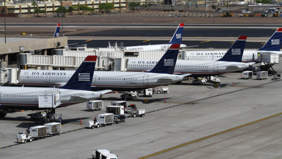 PHOENIX, AZ - APRIL 19: US Airways airplanes sit at terminal four gates at Sky Harbor International Airport on April 19, 2012 in Phoenix, Arizona. As American Airlines continues through bankruptcy US Airways is working on a possible deal to takeover the troubled airline. (Photo by Joshua Lott/Getty Images)