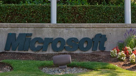 A sign displays the Microsoft logo in front of the company