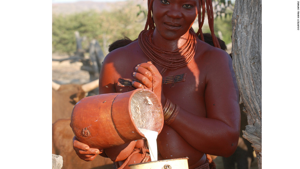 Every morning, Himba women wake at or before dawn, apply their <em>otjize</em>, then milk the livestock.