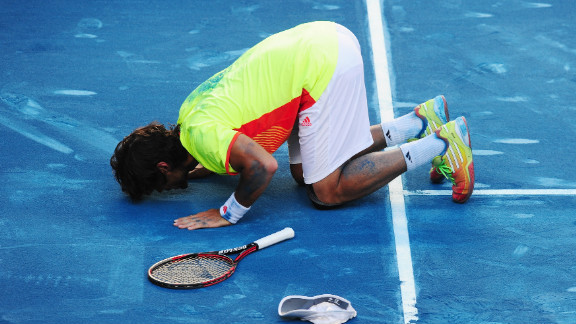 """Fernando Verdasco kisses the blue clay in Madrid after beating world No. 2 Rafael Nadal in a huge upset. """"I never was in control of the match, I didn't know how to win a point,"""" said Nadal, who is the modern era's """"King of Clay."""""""