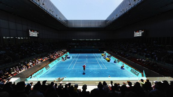 The blue clay court is made the same way as the red, with bricks ground into tiny fragments and spread over the ground in two different layers. However, in Madrid these bricks are stripped of their iron oxide (the chemical that provides the original color) and then treated with dye.
