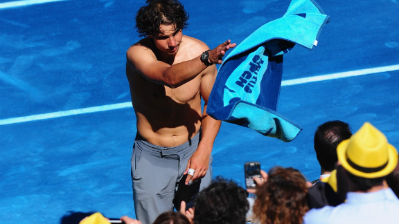 Nadal throws his towel -- emblazoned with the logo of sponsor Mutua Madrilena -- into the crowd. Tiriac says improving the experience for television viewers watching his $10.6 million tournament was a major factor in the switch to blue.