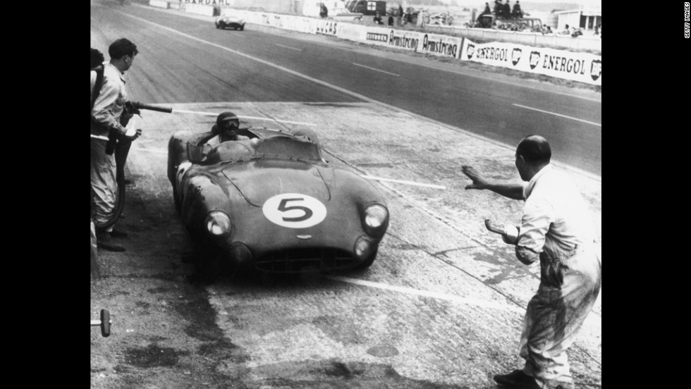 Shelby and Ray Salvadori's Aston Martin DBR1/300 stops at the pits during the 24 Hours of Le Mans in 1959. The car won the race by one lap.