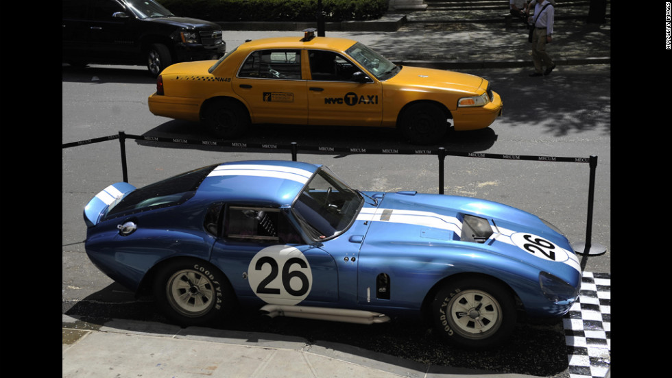 The 1965 Shelby Daytona Cobra Coupe CSX260 stands on display in front of New York's Plaza Hotel during an auction preview in 2009. The 1965 Shelby Daytona Cobra was one of six cars built by Carroll Shelby and the first American race car to beat Ferrari in the world manufacturers racing championship. The coupe sold for a record $7.25 million.
