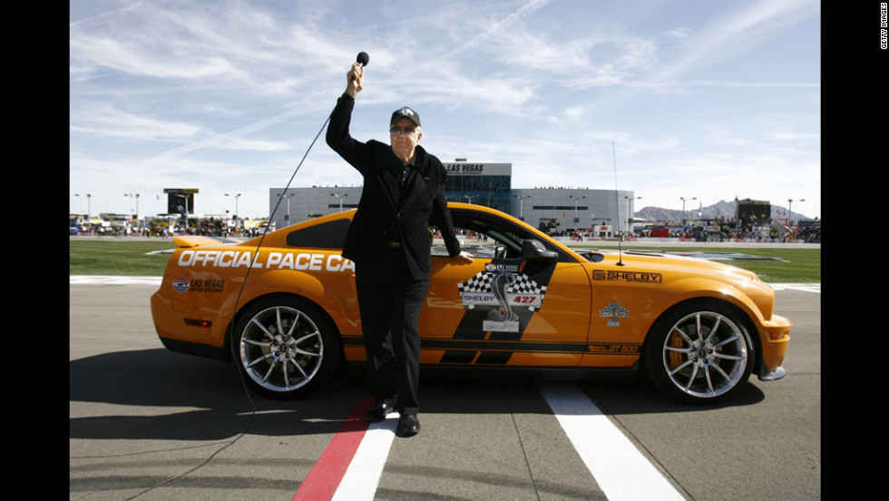 "Grand Marshall Carol Shelby gives the ""gentlemen, start your engines"" call during the NASCAR Sprint Cup Series Shelby 427 at the Las Vegas Motor Speedway in 2009."