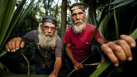 """Swamp People"" cast member Mitchell Guist, right, died Monday in Louisana. He is pictured here with his brother and co-star Glenn."