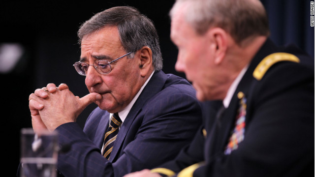 Secretary of Defense Leon Panetta, left, and Gen. Martin Dempsey, chairman of the Joint Chiefs of Staff, attend a news briefing at which Panetta asked Congress not to add any program spending to the federal budget that the Pentagon doesn't need.