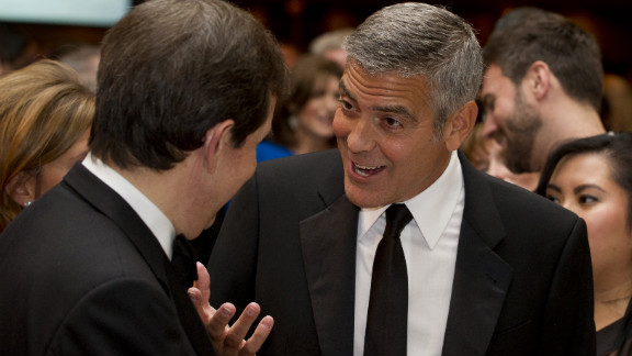 George Clooney, right, talks with Chris Wallace on April 28. Clooney