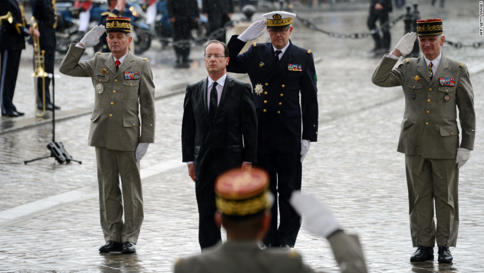 French President Francois Hollande pays his respects after laying a wreath at the Tomb of the Unknown Soldier at the Arc de Triomphe in Paris on Tuesday, May 15.