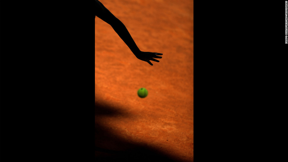 American Venus Williams returns the ball to Romania's Simona Halep  during their second-round match at the Italian Open Tennis Tournament in Rome's Foro Italico on Tuesday.