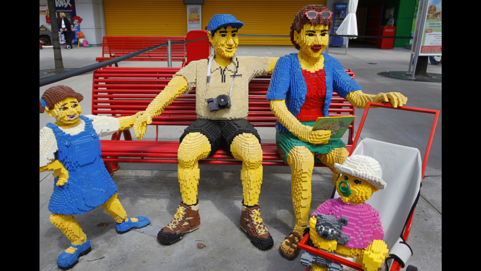 A family made of Lego bricks sits on a bench Tuesday at the Legoland theme park in Guenzburg, Germany. The park will celebrate its 10th anniversary on Thursday.