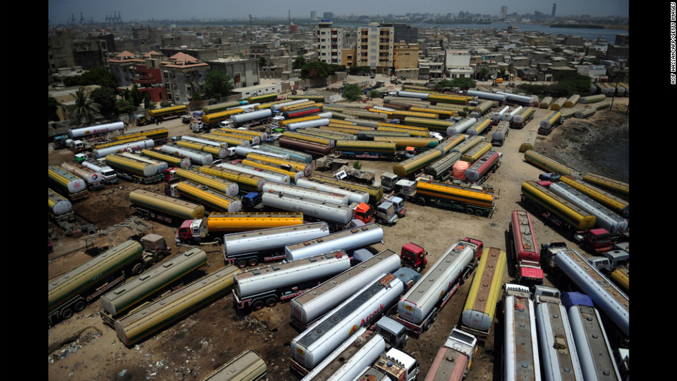 Tank trucks, used to transport fuel to NATO forces in Afghanistan, are seen parked near oil terminals in Pakistan's port city of Karachi on Tuesday. Pakistan appeared ready to end a nearly six-month blockade of NATO ground supply routes into Afghanistan.