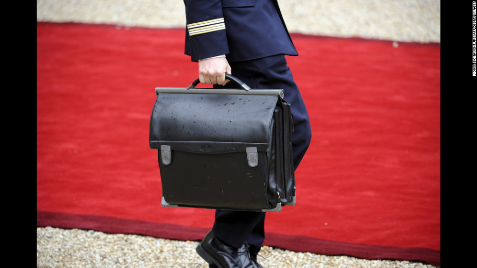 An officer walks with the nuclear satchel of France's President Francois Hollande during Tuesday's formal investiture ceremony at the Elysee Palace in Paris.