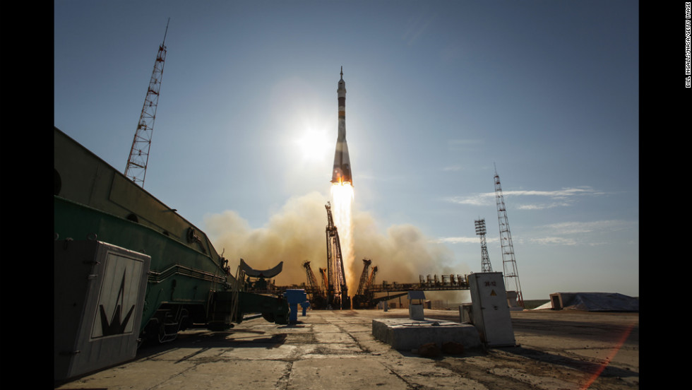 In an image provided by NASA, the Soyuz TMA-04M rocket launches Tuesday from the Baikonur Cosmodrome in Kazakhstan. The rocket is carrying three crew members to the International Space Station.