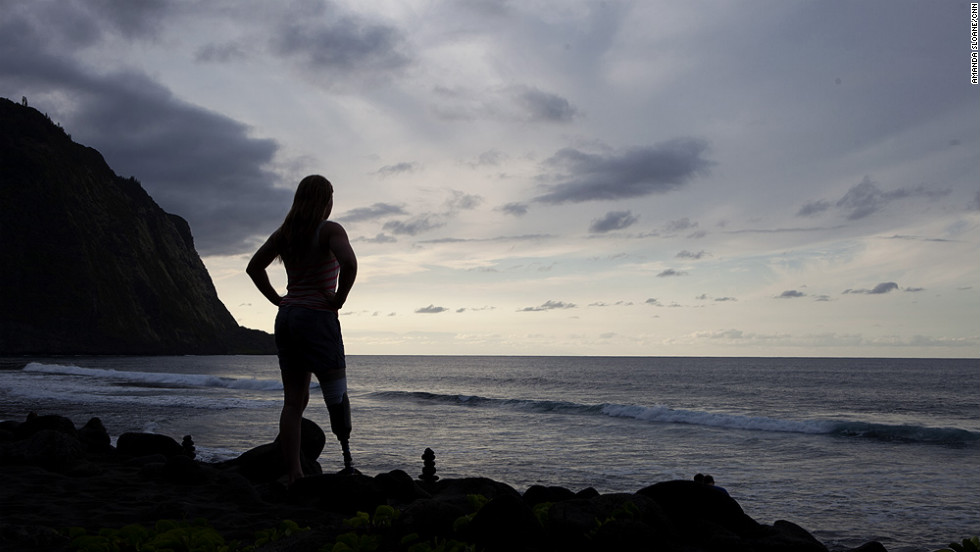 Castelli takes in the scenic beauty of the black sand beach in Waipio Valley.