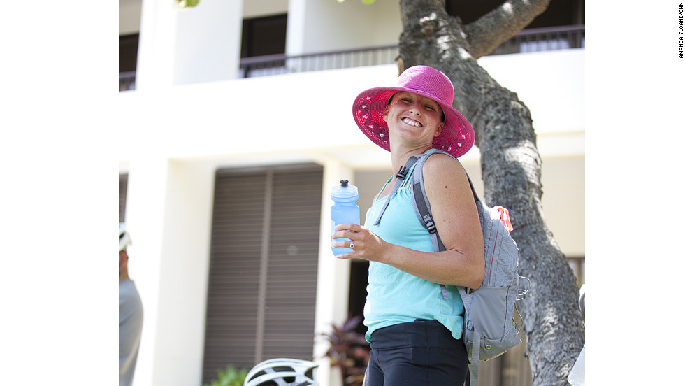 "Fit Nation athletic director April Burkey rocks a pink hat while waiting for the ""Lucky 7"" to get fitted for rental bikes in Hawaii."