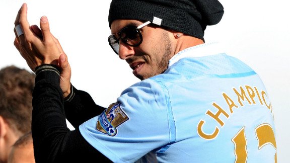 """Carlos Tevez was forced to apologize after holding up a banner saying """"R.I.P. Fergie"""" during Manchester City"""