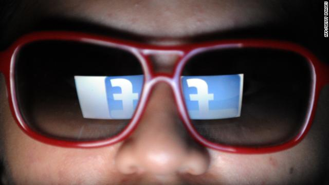 A logo of social networking facebook is reflected on the spectacles of a student browsing the website in Manila on May 14, 2012. Facebook may be the year's hottest stock issue -- but try getting a piece of it. Small investors will find the line long and hurdles high to get even a handful of shares.  AFP PHOTO/TED ALJIBE        (Photo credit should read TED ALJIBE/AFP/GettyImages)