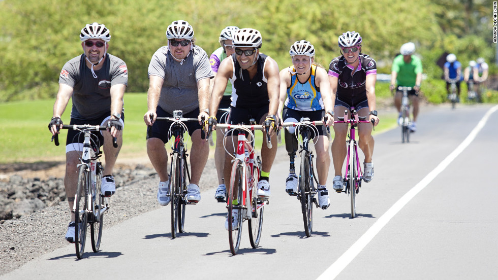 "The Fit Nation participants head off for a bike ride along the ""Queen K"" highway in Hawaii."