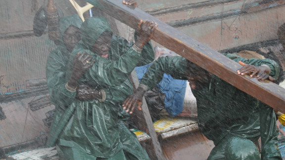 """Characters in """"La Pirogue"""" weather treacherous conditions in their wooden boat."""