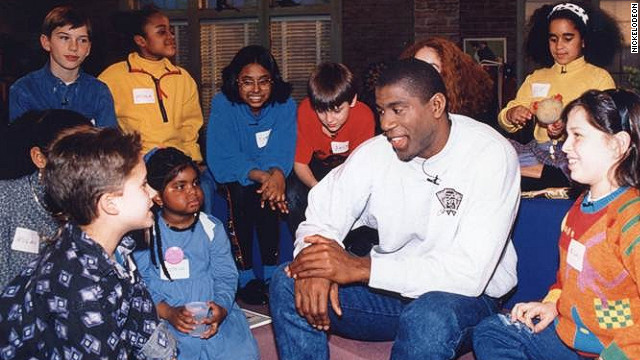 Hydeia Broadbent, in blue dress, sits next to Magic Johnson in a TV special for Nickelodeon 20 years ago.