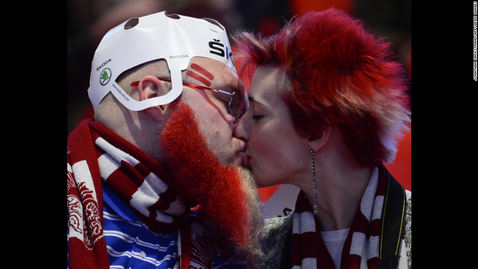 Latvian fans kiss on Tuesday ahead of a preliminary round match against Sweden at the Ice Hockey World Championships in Stockholm.