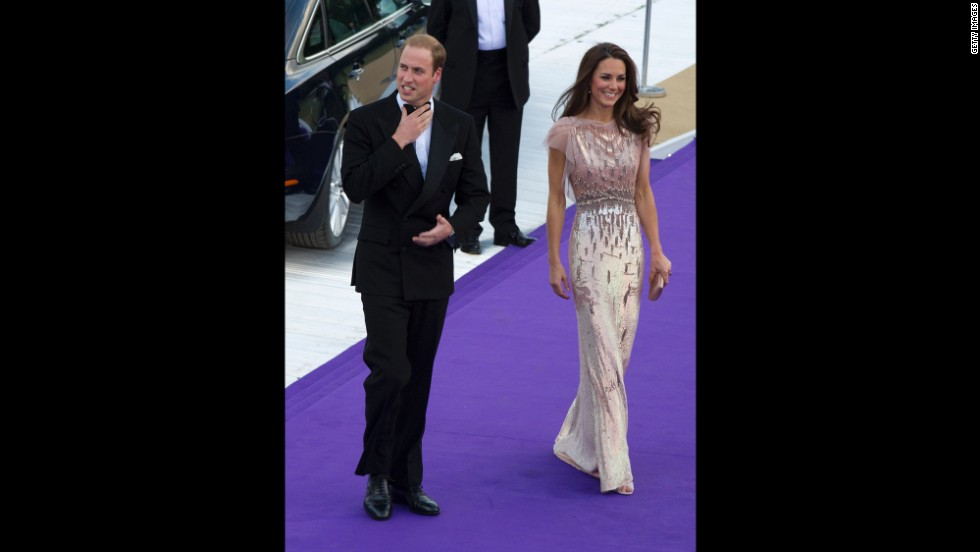 Stepping out in another Jenny Packham gown, Kate attends a gala at London's Kensington Palace with William on June 9 2011.