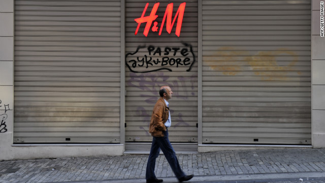 A man passes by a closed shop in central Athens shopping area during a general strike last fall.