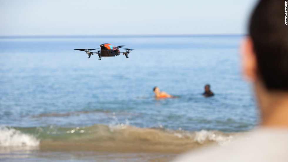 Fit Nation producer Matt Sloane uses an aerial drone to capture video of the group in the water.