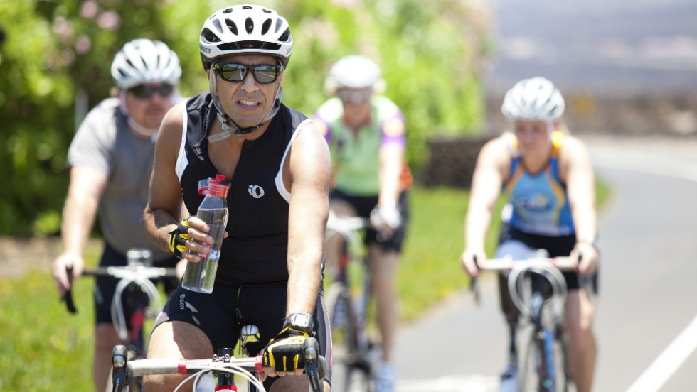 Gupta stays hydrated during the bike ride through the lava fields.