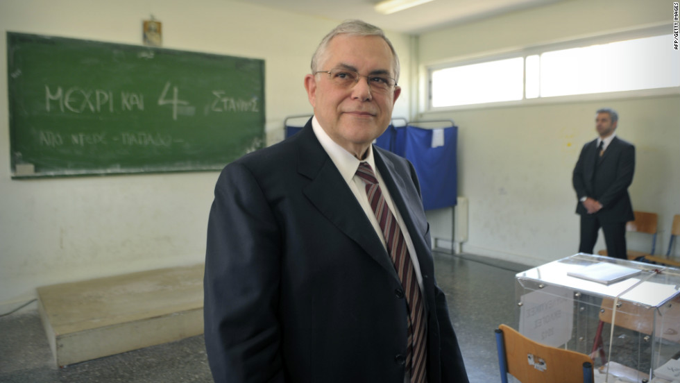 Former Greek Prime Minister Lucas Papademos prepares to cast his vote at the May 6 elections. Papademos was tasked with implementing Greece's second bailout package, which it was forced to take after the first aid package, given two years ago, failed to push the country out of recession.