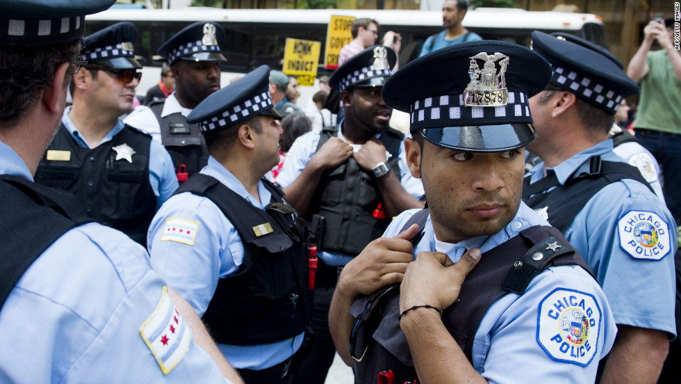 Chicago police watch over protesters during demonstrations organized by National Nurses United in Daley Plaza in Chicago.