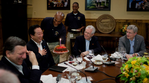 Delegates celebrate the Japanese prime minister