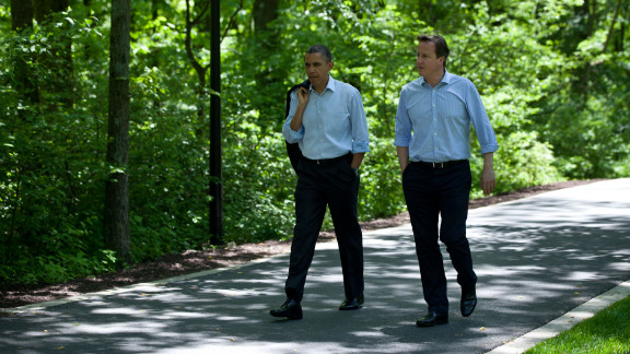Obama and Cameron talk as they make their way to Laurel Cabin.