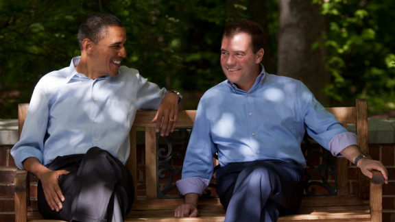 Obama and Medvedev talk on the Laurel Cabin patio.