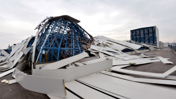 The roof of a ceramics factory is left damaged by the powerful earthquake that shook Sant'Agostino village.
