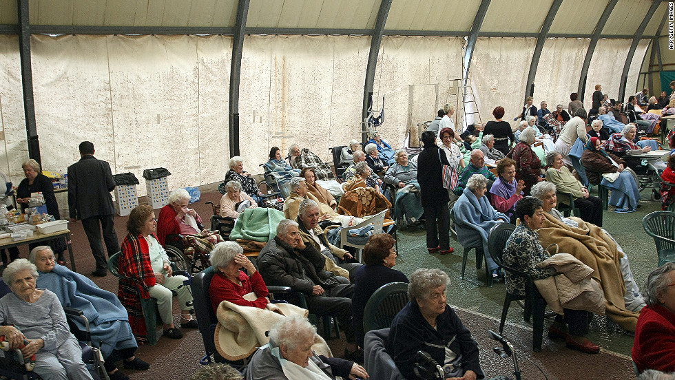 Elderly people rest after being evacuated to a sports center in Finale Emilia after the quake.