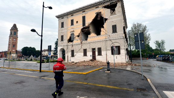 A rescuer walks near the town hall in Sant'Agostino village after a powerful earthquake shook Italy's industrial and densely populated Northeast early on Sunday, May 20.
