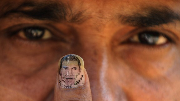 Indian micro-artist Ramesh Sah shows the nail of his thumb painted with an image of Barack Obama in support of his visit to India in 2010.